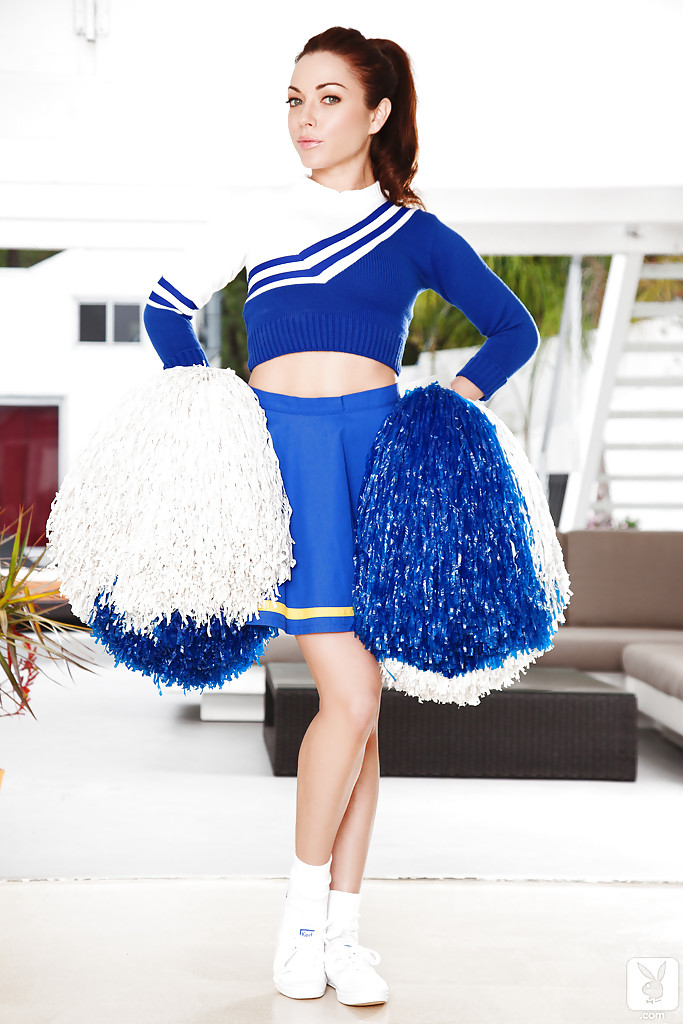 Adorable brunette cheerleader slowly uncovering her petite curves