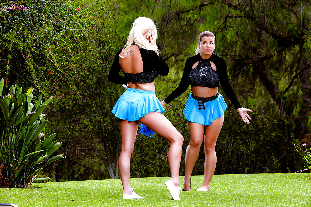 Cheerleaders Adriana Sephora and Spencer Scott go girl on girl outdoors
