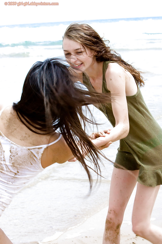 Amateur models Carly T and Silvie bare naked teen bodies at the beach