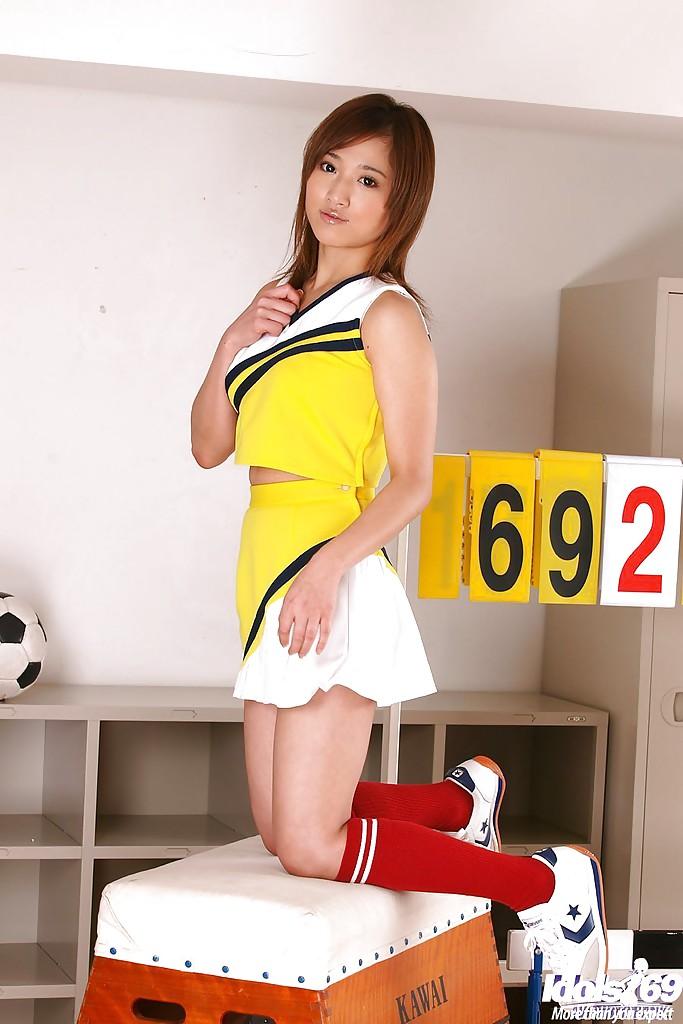 Loveable asian girl Caren Hasumi taking off her cheerleader uniform