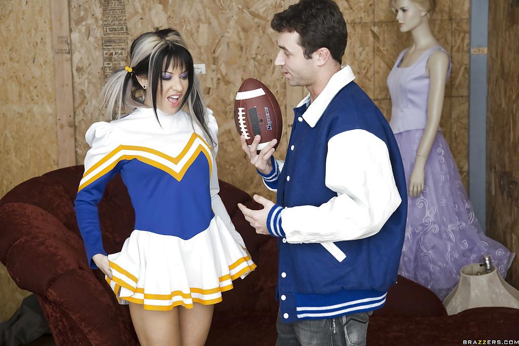 Naughty cheerleader Helly Hellfire gives a blowjob and gets banged