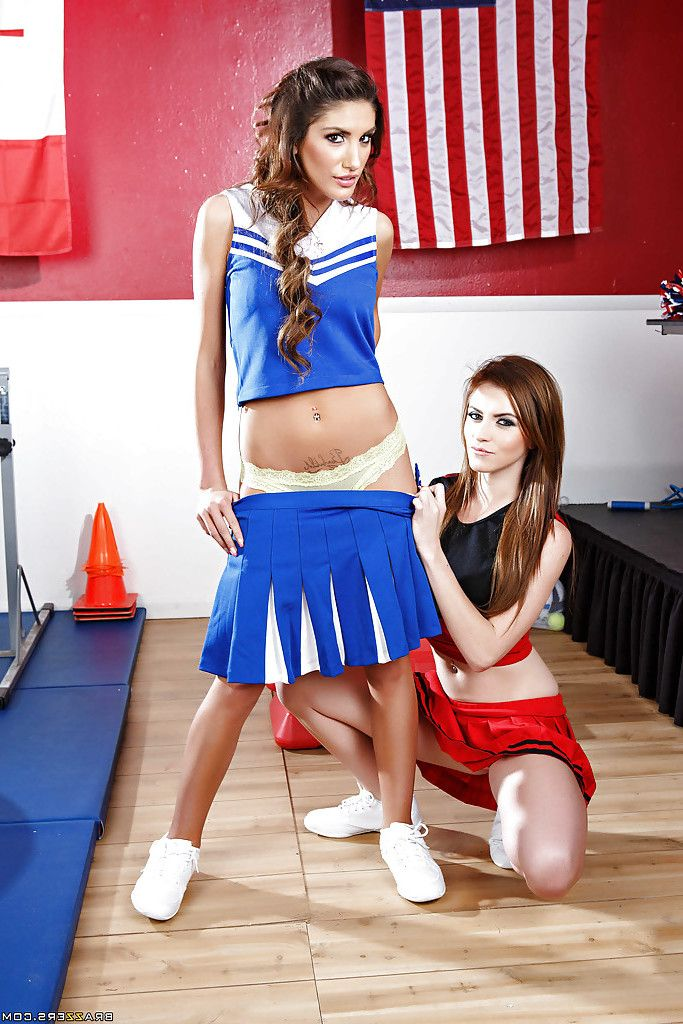 Girl-on-girl cheerleaders August Ames and Emma Stoned showing their booties