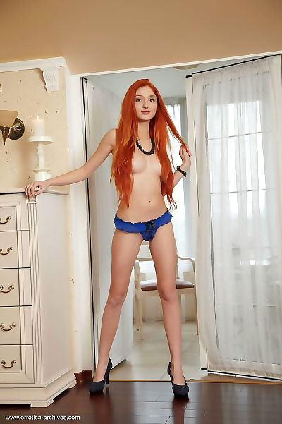 Common redhead pulls down her underclothes to showcase her smooth head bawdy cleft