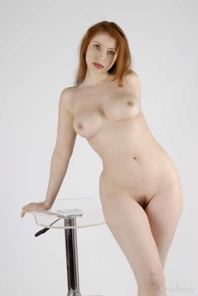 Bare redhead Alixia throws her hair in the past as that babe flaunts her sticky body