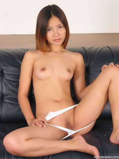 Slender Japanese infant pulls down lace strings as that babe finishes undressing