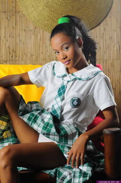 Youthful Eastern chicito removes her school uniform to sample nude in a necktie