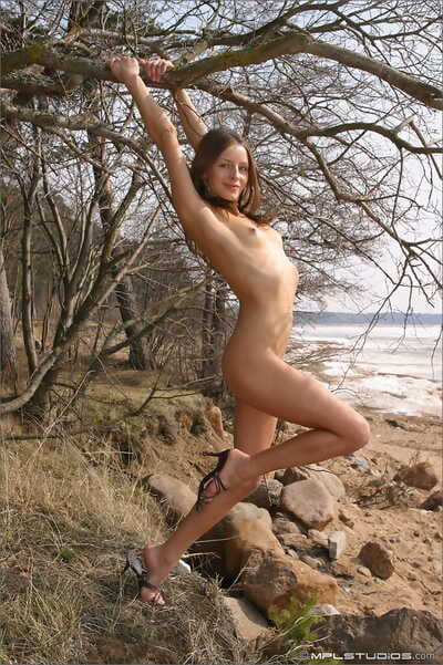 Super slim European princess touching her captivating bare body outdoors