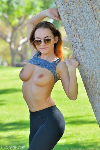 Sports babe Charlotte removes clothes her pumped up costume for a exposed public romp