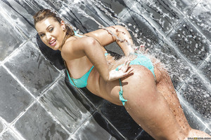 European babe Klara Gold shows off her wazoo right in the pool