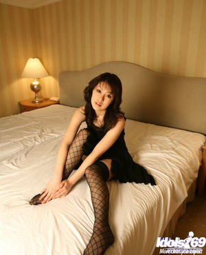 Elegant oriental youthful in openwork  takes off her costume and underclothing