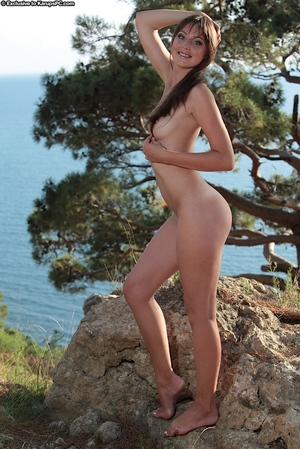 Admirable infant with slender twists and shiny on top pussy posing unclothed outdoor