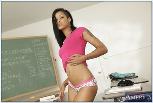 Ebon college angel Skin Diamond removes clothes in the class and masturbates