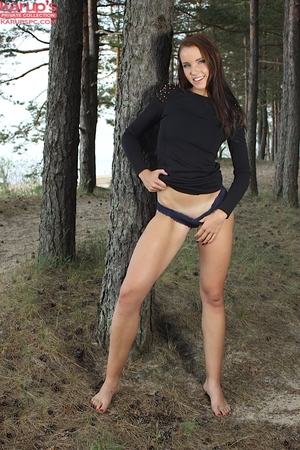 Youthful outdoor posing from a spectacular youthful angel Lorette in panties