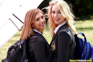 Young schoolgirls Cali Sparks and Kelly Greene tongue kissing outdoors