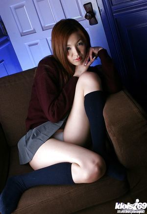 Miniscule asian teen-age pretty uncovering her whoppers and furry pussy