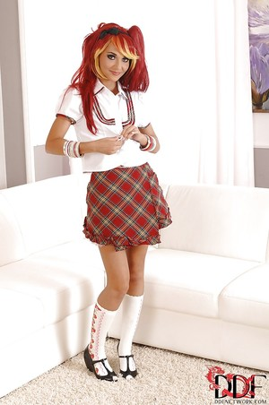Foxy schoolgirl in glasses and desire uniform uncovering her mini bows
