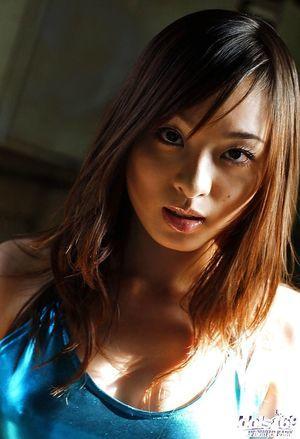 Foxy oriental pretty Hikaru Koto has no shorts below her fishnet pantyhose