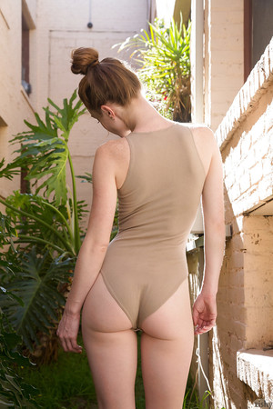 Sweet redhead young Julie Wheeler showing off her anus outdoors