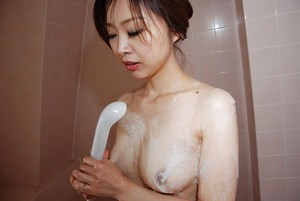 Cheery oriental young Mariko Miyazawa getting bare and delightsome bath