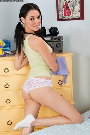 Charming adolescent young in lacy panties undressing and posing on the sofa
