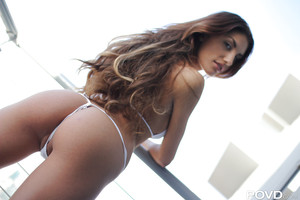 Vast tits young doll August Ames shows off her waste in a bikini