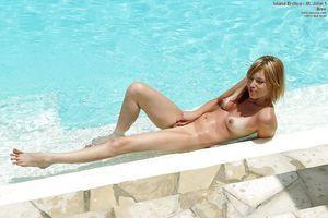 Seductive youthful vixen in bikini showcasing her sticky body outdoor