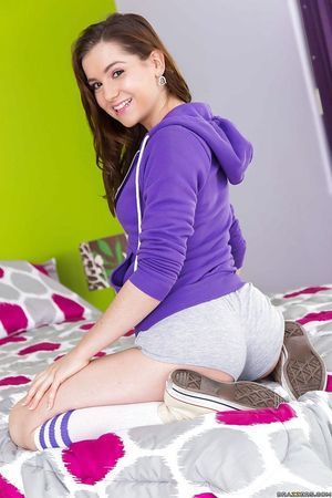Small teenager Kasey Warner pulls underclothing down over knee high socks