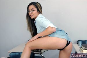 Sexy coed in glasses Michelle Maylene disrobes and shows glamorous holes