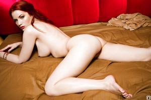 Redhead vixen Kinsey Elizabeth slipping off her pink underware