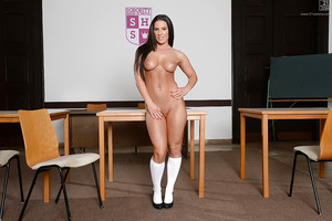 Brunette hair schoolgirl Athina posing in uniform and flashing white underclothes