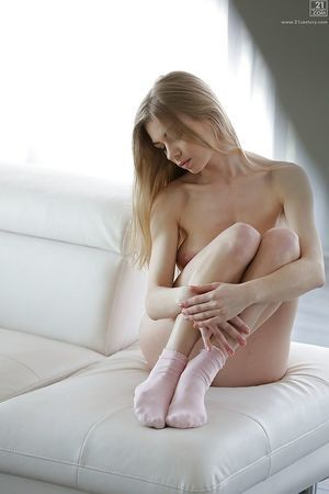 Tall pornstar Lolly Gartner modelling solo in white strings and socks