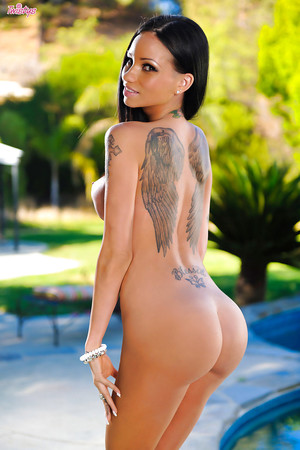 Considerate brown hair gal Raven Bay shows her intimate tattoos