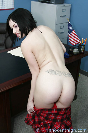 Office juvenile puts up her petticoat to show large ass and sexy pants