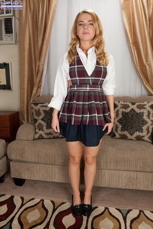 Amateur teenager Alina West posing on casting ottoman in schoolgirl outfit