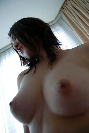 Chinese amateur in pipe undressing and exposing her curly gash in close up