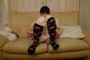 Chinese juvenile in knee socks fascinating off her underclothes and exposing her shaved gash