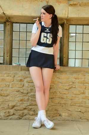 18 year old schoolgirl Jessica-Ann Fegan having smoke in cheerleader outfit