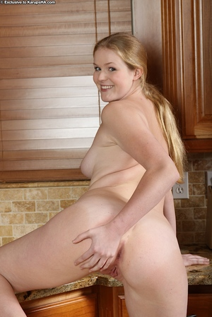 Joyful amateur with ample waste getting bare and showcasing her holes