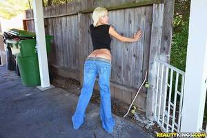 Trashy amateur Emma Mae pulls down jeans and flashes in the street