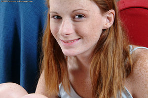 Thin redhead Allison is showing her smooth on top uterus in close up