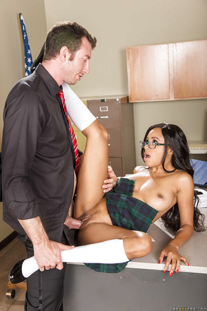 Youthful and busty swarthy schoolgirl Anya Ivy smoking the tutor on desk