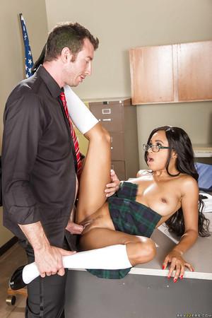 Youthful and busty swarthy schoolgirl Anya Ivy smoking the tutor on desk