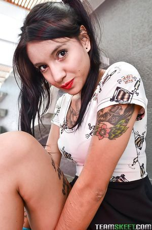 Tatted teen Mara likes showing off her tense tatted body on web camera