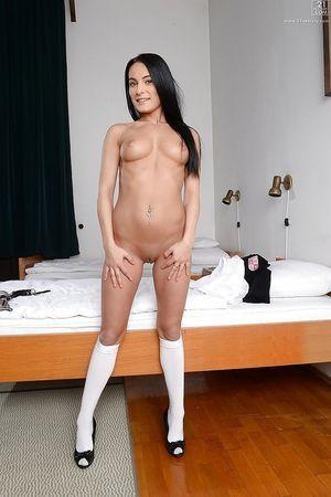 Elegant brown hair schoolgirl Lexi Dona posing in petticoat and white socks