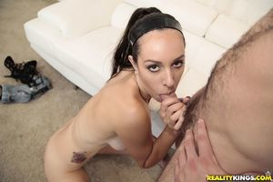 Adolescent dark brown doxy Amber Taylor giving head on knees and swallowing goo