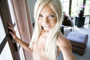 Blonde slim infant Katerina Kay posing and showing off her shaved uterus