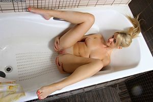 Lusty amateur Joan Miller teasing her muff with shower jets and her fingers