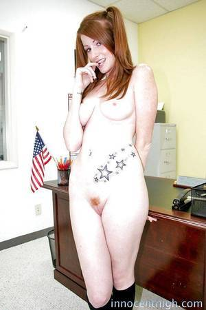Redhead slut with pigtails Nikki undressing that attractive body
