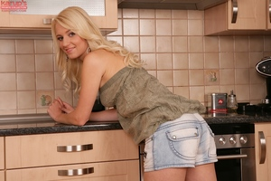 Slimy juvenile getting naked and fingering her shaved fur pie in the kitchen