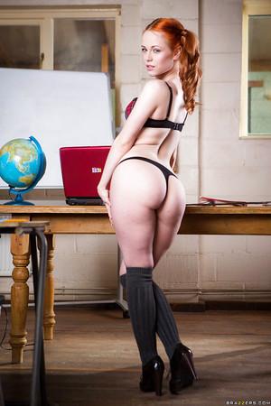 Redhead schoolgirl Ella Hughes posing in pigtails whereas revealing compact meatballs